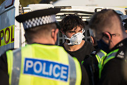 Hertfordshire Police arrest an environmental activist from HS2 Rebellion who, together with another activist, had used a lock-on arm tube to block a gate to the South Portal site for the HS2 high-speed rail link on 14 September 2020 in West Hyde, United Kingdom. Anti-HS2 activists blocked two gates to the same works site for the controversial £106bn rail link, one remaining closed for over six hours and another for over twelve hours.
