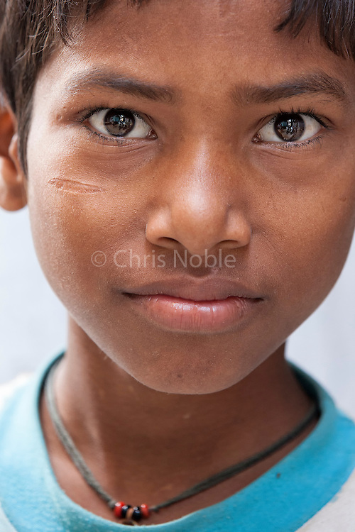"Portrait of a young boy in the ""galis"" (alley ways) of the Old City of Varanasi India."