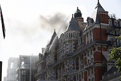 © Licensed to London News Pictures. 06/06/2018. London, UK. Fifteen fire engines and 97 firefighters and officers have been called to a fire believed to be at the Mandarin Hotel in Kightsbridge. Photo credit: Peter Macdiarmid/LNP