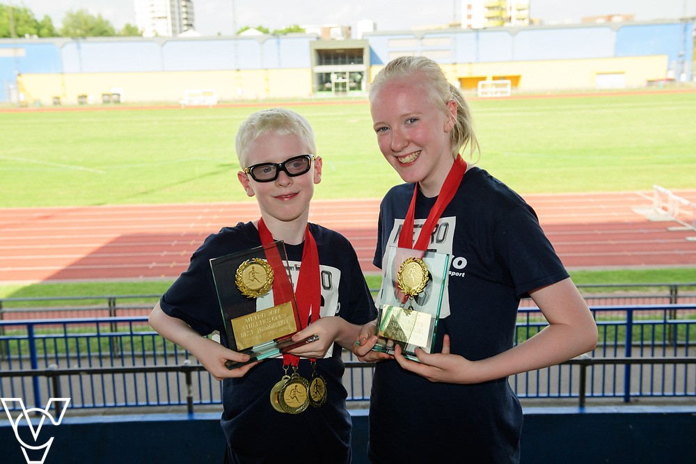 Metro Blind Sport's 2017 Athletics Open held at Mile End Stadium.  Medal presentations.  Eoin Quigley, left, and Emma Quigley<br /> <br /> Picture: Chris Vaughan Photography for Metro Blind Sport<br /> Date: June 17, 2017