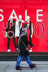 © Licensed to London News Pictures. 26/04/2016. CITY, UK.  General view of shops in Oxford Street with sale signs in their windows a week before Christmas. It has been reported that record discounts are being offered to tempt shoppers to spend. Photo credit: Cliff Hide/LNP