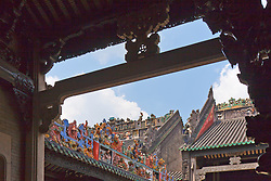"Elaborate roofing detail framed by carved arch, The Chen Clan Ancestral Hall temple in Guangzhou, China.  Built by the 72 Chen clans for their juniors' accommodation and preparation for the imperial examinations in 1894 in Qing Dynasty, it now houses the Guangdong Folk Art Museum and is a symmetric complex consist of 19 buildings with nine halls and six courtyards.  A large collection of southern China art pieces stud all portions of the building.  It was added in the list of ""Cultural Relics of National Importance under the Protection of the State"" in 1988."