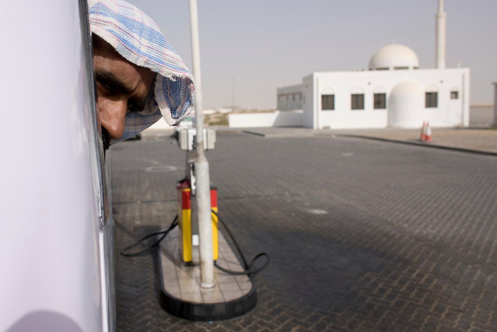 Dubai . foreign worker in Bus at rest stop on  Sheikh Zayed Road entering Dubai from  Abu Dhabi
