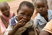 Children enjoy their lunch outside the Nyologu Primary School in the village of Nyologu, northern Ghana, on Wednesday June 6, 2007. .
