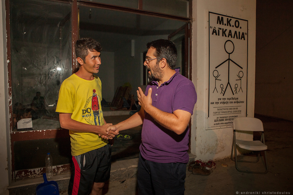 Giorgos Tirikos Ergas, one of the founding members of NGO Aggalia in Kaloni, talking with a refugee. He and his wife spend almost all of their free time taking care of refugees.