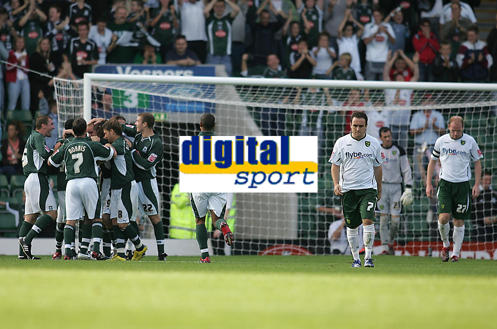Photo: Lee Earle.<br /> Plymouth Argyle v Norwich City. Coca Cola Championship. 23/09/2006. Norwich's Lee Croft (2ndR) and Gary Doherty (R) look dejected as Plymouth players celebrate scoring their second.