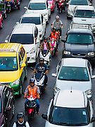 20 MAY 2015 - BANGKOK, THAILAND: Motorcycles in between lanes in traffic on Ratchadamri Road at the Ratchaprasong Intersection. Bangkok has some of the most congested traffic in the world.    PHOTO BY JACK KURTZ