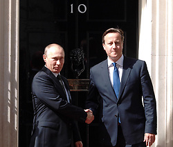Prime Minister David Cameron welcomes Russian President  Vladimir Putin outside 10 Downing Street in London, Sunday, 16th June 2013<br /> Picture by Max Nash / i-Images
