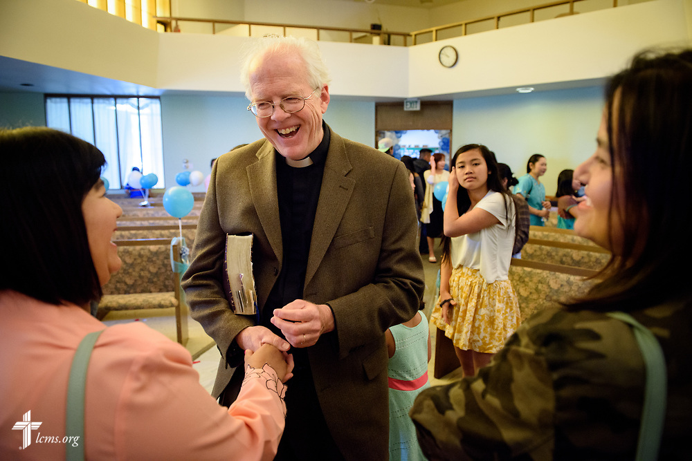 The Rev. Doug Wagley, pastor of New Vision Lutheran Church, Spokane, Wash., visits with guests following a traditional Burmese wedding held at New Vision on Saturday, June 17, 2017, in Spokane. LCMS Communications/Erik M. Lunsford