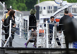 Singer Katy Perry seen boarding a ferry on the Thames from the Savoy pier in London, heading to the O2 Greenwich. Katy with green hair and bright orange sunglasses wore a short mini dress, with a black jacket, tights and purple high heel shoes. London, UK. 30/05/2014<br />BYLINE MUST READ : GOTCHAIMAGES.COM<br /><br />Copyright by © Gotcha Images Ltd. All rights reserved.<br />Usage of this image is conditional upon the acceptance <br />of Gotcha Images Ltd, terms and conditions available at<br />www.gotchaimages.com