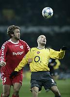 Photo: Barry Bland.<br />FC Thun v Arsenal. UEFA Champions League. 22/11/2005.<br />Milicevic and  Fredrik Ljungberg.