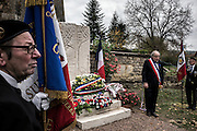 Parigny la Rose's mayer Nicolas Maurice pays tribute to fallen soldiers in front of the brand new memorial during the first WWI armistice ceremony, on November 11, 2015 in Parigny la Rose. AFP PHOTO / JEFF PACHOUD