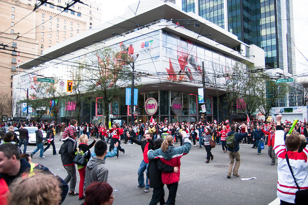 Fans begin to gather in their masses at the Robson Street &amp; Burrard Street intersection in Downtown Vancouver.<br /> <br /> Tens of thousands of people in Vancouver took to the streets on Sunday 28th February 2010 to celebrate Canada's 3-2 overtime win over the United States for the gold medal in men's Olympic hockey...Traffic came to a halt in and around the downtown of the host city for the Winter Games following the dramatic finish to the match, which featured Sidney Crosby scoring to secure the victory on the final day of Olympic competition.