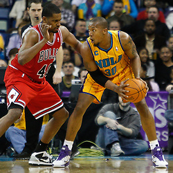 February 12, 2011; New Orleans, LA, USA; New Orleans Hornets power forward David West (30) is guarded by Chicago Bulls center Kurt Thomas (40) during the third quarter at the New Orleans Arena.  The Bulls defeated the Hornets 97-88. Mandatory Credit: Derick E. Hingle