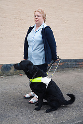Visually impaired woman with guide dog,
