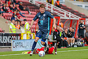 Bury defender Chris Stokes (3) on the ball during the EFL Sky Bet League 2 match between Swindon Town and Bury at the County Ground, Swindon, England on 15 September 2018.