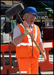 London Mayor Boris Johnson lays a slab on the new square at the King's Cross station redevelopment site, London, United Kingdom<br /> Wednesday, 7th August 2013<br /> Picture by Andrew Parsons / i-Images