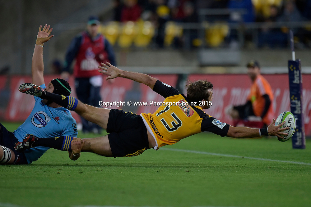 Hurricanes' captain Conrad Smith (R reaches out for the ball as he is tackled by Waratahs' Stephen Hoiles during the Super Rugby - Hurricanes v Waratahs rugby union match at the Westpac Stadium in Wellington on Saturday the 18th of April 2015. Photo by Marty Melville / www.Photosport.co.nz