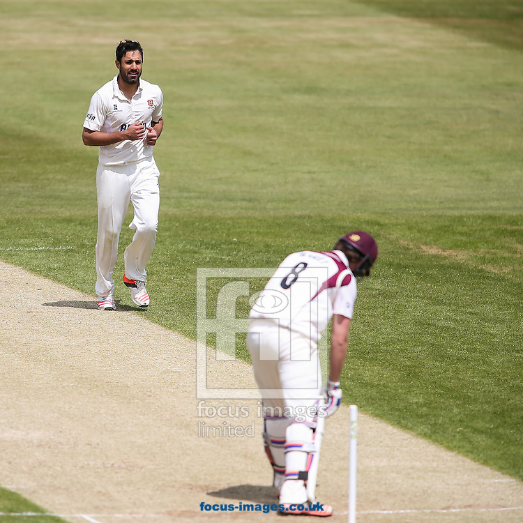 Ravi Bopara of Essex (left) smiles afer bowling Alex Wakely of Northamptonshire (right) during the LV County Championship Div Two match at the County Ground, Northampton<br /> Picture by Andy Kearns/Focus Images Ltd 0781 864 4264<br /> 08/06/2015