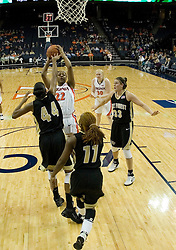 UVA's Monica Wright shoots over Wake Forest's Mekia Valentine (44).  The Cavaliers defeated the Demon Deacon 77-71 on January 11, 2007 for their first ACC win in the John Paul Jones Arena in Charlottesville, VA.<br />