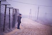 December 10, 1989. Bratislava/Devin, Czechoslovakia. A soldier guarding the Iron Curtain at the border to Austria. (Photo Heimo Aga)