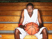 Basketball player holding ball portrait