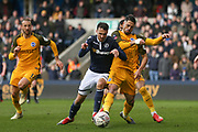 Millwall forward Lee Gregory (9) battles with Brighton and Hove Albion midfielder Beram Kayal (7) during the The FA Cup quarter final match between Millwall and Brighton and Hove Albion at The Den, London, England on 17 March 2019.