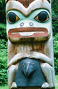 Alaska. Sitka Nat'l Historical Park. RA. <br /> K'alyaan Pole, Frog, holding raven helmet.