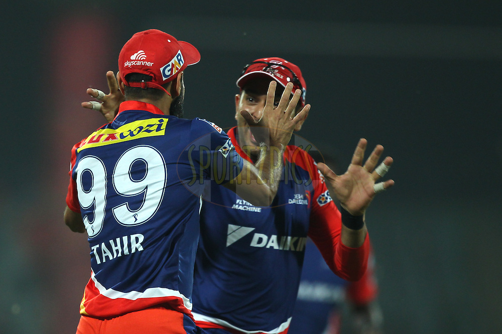 Imran Tahir , Yuvraj Singh of the Delhi Daredevils  celebrates the wicket of Parthia Patel of the Mumbai Indians  during match 21 of the Pepsi IPL 2015 (Indian Premier League) between The Delhi Daredevils and The Mumbai Indians held at the Ferozeshah Kotla stadium in Delhi, India on the 23rd April 2015.<br /> <br /> Photo by:  Deepak Malik / SPORTZPICS / IPL