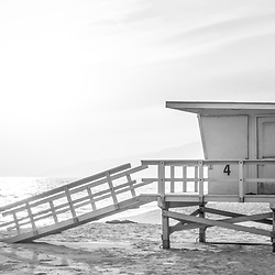 Malibu Zuma Beach lifeguard tower #4 sunset black and white panorama. Malibu is a coastal beach city in Southern California in the United States or America. Panoramic photo ratio is 1:3. Copyright ⓒ 2015 Paul Velgos with All Rights Reserved.