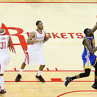 25 May 2015: Golden State Warriors forward Draymond Green (23) goes for the layup past Houston Rockets guard Jason Terry (31) and Houston Rockets forward Trevor Ariza (1) during the Houston Rockets 128-115 victory over the Golden State Warriors, in game 4 of the Western Conference finals, at the Toyota Center, Houston, Texas, USA.