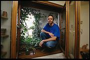 "The Hundertwasserhaus, the first and most famous public housing project by Austrian artist and architekt Friedensreich Hundertwasser..Mr. M. and his ""window garden""."