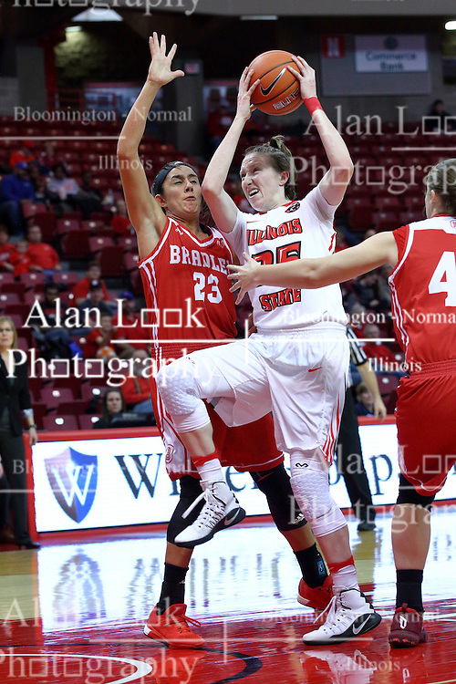 01 January 2017: Hannah Green goes for two whild defended by Leti Lerma and Vanessa Markert during an NCAA Missouri Valley Conference Women's Basketball game between Illinois State University Redbirds the Braves of Bradley at Redbird Arena in Normal Illinois.