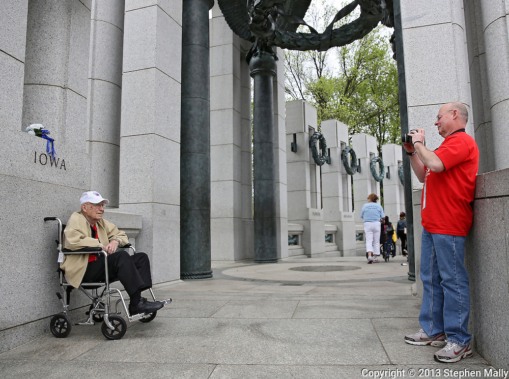 Korea War Veteran Rogert Cook (from left) has his picture taken by his son, Doug Cook, both of Independence in front of the Iowa pillar during the Sullivan-Hartogh-Davis Post 730 Honor Flight at the National World War II Memorial in Washington, DC on Tuesday, April 16, 2013. About 90 veterans were on the trip. After their visit to the National World War II Memorial they would take a bus tour of Washington, DC followed by a visit to the Korean War Veterans Memorial.