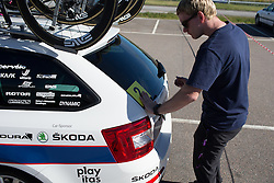 A Cervélo-Bigla Cycling Team team mechanic applies the day's number sticker on the car before the 117,5 km third stage of the 2016 Ladies' Tour of Norway women's road cycling race on August 13, 2016 between Svinesund, Sweden and Halden, Norway. (Photo by Balint Hamvas/Velofocus)