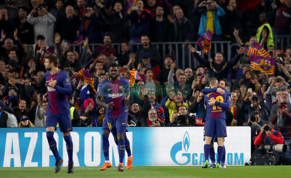 Barcelona's Lionel Messi (right) celebrates scoring his side's first goal of the game