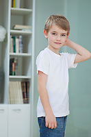 Portrait of a little boy in casuals at home