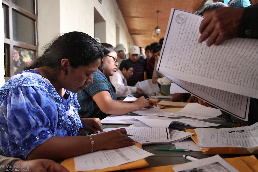 Lolita Chávez, coordinator of the K'iche' People's Council (Consejo de Pueblos K'iche's, or CPK, in Spanish), helps check the results from the community consultation on the exploitation of natural resources in Santa Cruz del Quiché. The final results were resounding: 98% of the adults voted; 27,778 rejected the extraction and exploitation of their natural goods and resources, while zero voted in favor. The municipality's population stands at 62,369, yet more than half are under age, which means most of the adults did indeed vote. Santa Cruz, Quiche, Guatemala. October 22, 2010.