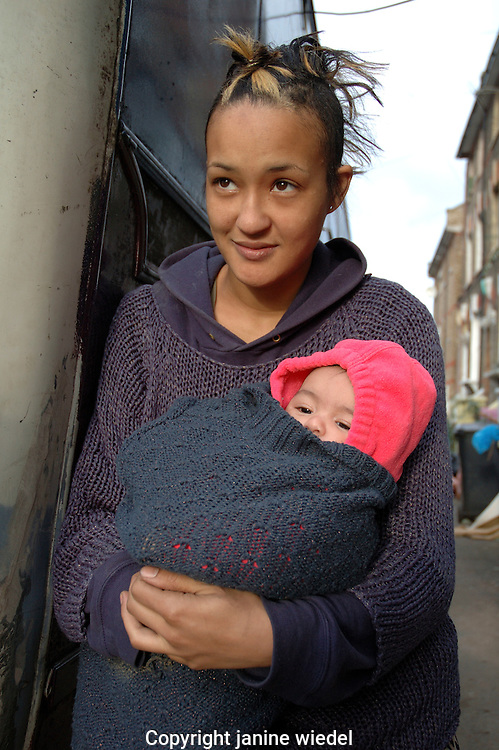 Young Mother and baby living as Newage traveller in horse van in central London.