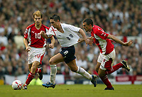 Photo: Aidan Ellis.<br />England v Austria. World Cup Qualifier. 08/10/2005.<br /><br />England's Frank Lampard (C) has his shirt pulled by Austria's Roland Linz.