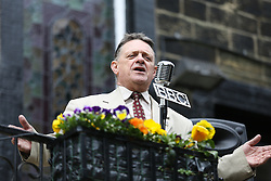 © Licensed to London News Pictures. 13/05/2016. Haworth, UK. A man sings in the street during the annual 1940's weekend in Haworth, West Yorkshire.  Photo credit : Ian Hinchliffe/LNP