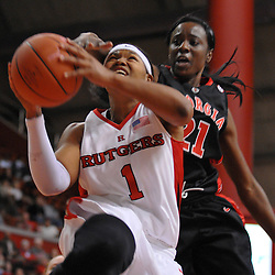 Dec 7, 2008; Piscataway, NJ, USA; Rutgers guard Khadijah Rushdan (1) battles Georgia Lady Bulldog defenders under the hoop during the second half of Rutgers' 45-34 victory over Georgia in the Jimmy V Classic at Louis Brown Athletic Center.