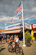 Brooklyn; New York; U.S. - August 9; 2014 - A man is walking his bike at the Fourth Annual History Day at Deno's Wonder Wheel Amusement Park and The Coney Island History Project, which had family fun music, history, and entertainment at historic Coney Island.