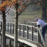 Pat O'Callaghan gets a few minutes alone on the pier to reflect before the start of the annual Veterans Day ceremony at Veterans Park Saturday morning in Tupelo.