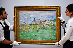 "© Licensed to London News Pictures. 14/06/2019. LONDON, UK. Technicians hang ""Printemps à Giverny, effet du matin"", 1885, by Claude Monet (Est. £4-6m). Preview of Impressionist and Modern art sales, which will take place at Sotheby's New Bond Street on 18 and 19 June 2019.   Photo credit: Stephen Chung/LNP"