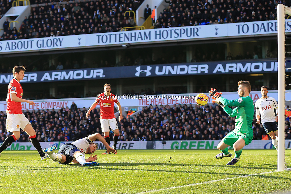 28 December 2014 - Barclays Premier League - Tottenham Hotspur v Manchester United - Harry Kane of Tottenham Hotspur looks on as his shot is saved by Manchester United goalkeeper, David de Gea - Photo: Marc Atkins / Offside.