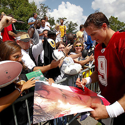 July 29, 2011; Metairie, LA, USA; New Orleans Saints quarterback Drew Brees (9) signs autographs following the first day of training camp at the New Orleans Saints practice facility. Mandatory Credit: Derick E. Hingle