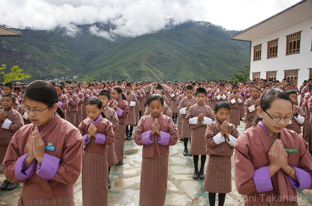 Students pray during daily morning assembly at Zilukha Lower Secondary School in Thimpu, Bhutan on August 14, 2014. In this Buddhist-dominated country, Buddhist morning prayer are compulsory in government schools. <br /> (Photo by Kuni Takahashi)