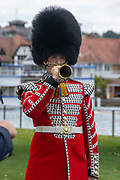 Henley on Thames, England, United Kingdom, Tuesday, 02.07.19, Bugler, of the Coldstream Guards, plays the last Post, Henley Royal Regatta,  Henley Reach, [©Karon PHILLIPS/Intersport Images]<br /> <br /> 13:42:45 1919 - 2019, Royal Henley Peace Regatta Centenary,