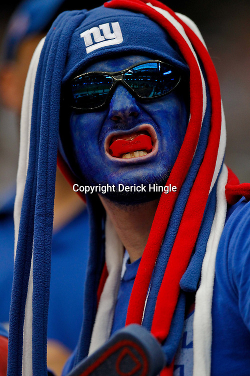 October 10, 2010; Houston, TX USA; A New York Giants fan in the stand prior to kickoff of a game against the Houston Texans at Reliant Stadium. The Giants defeated the Texans 34-10. Mandatory Credit: Derick E. Hingle